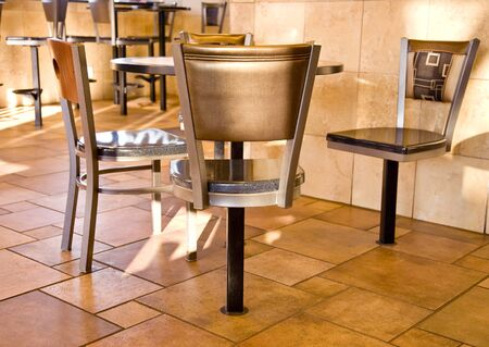 Seats and table at a fast food resturant.
