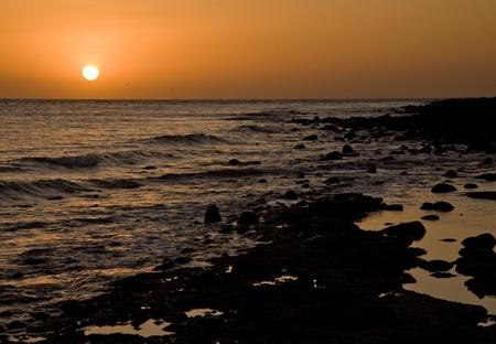 rocky point: Tramonto su una spiaggia rocciosa a Puerto Penasco (Rocky Point) Messico Archivio Fotografico