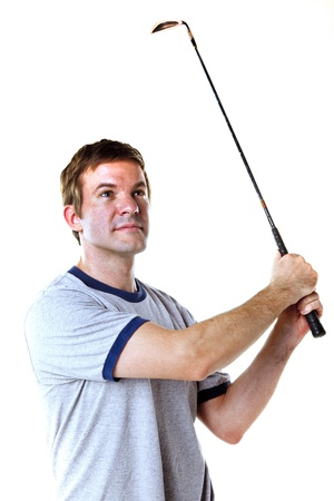 Man swinging a golf club isolated on white  Stock Photo - 19533240