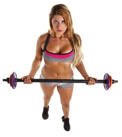 Woman exercising with barbell weights isolated on white  photo