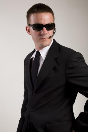 Secret Agent Reaches for Gun photo