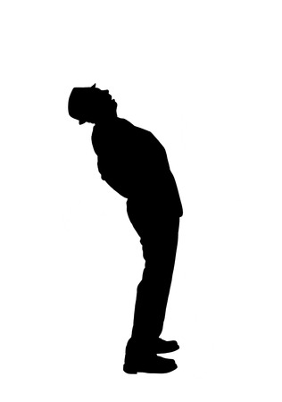 Silhouette of a Man Bending Over Backward to Look Up Stock Photo