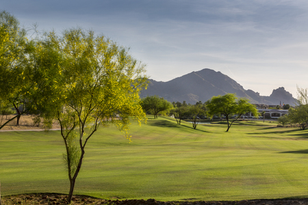 Evening falls over the Scottsdale Greenbelt Park and Camelback Mountain