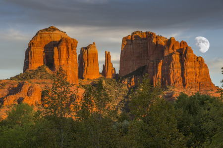 Cathedral Rocks at Sunset with rising moon in Sedona Arizona USA Stock Photo
