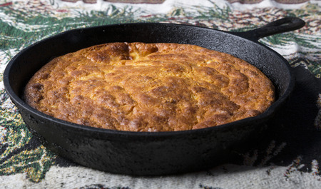 Home-Style corn bread in a cast iron skillet. Stock Photo
