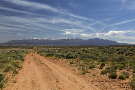 Four wheel drive trail across the desert to Moab Utah with the La Sal Mountains in the distance.