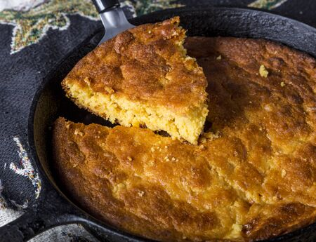Home Style corn bread in a cast-iron skillet. Stock Photo