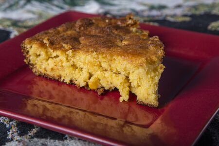 small plate: Home Style corn bread being served on a small plate. Stock Photo