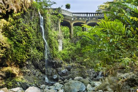 Brigde on the Hana Highway across the Wailua Nui Stream near the Upper Waikuni Falls on Maui Island in Hawaii. 写真素材
