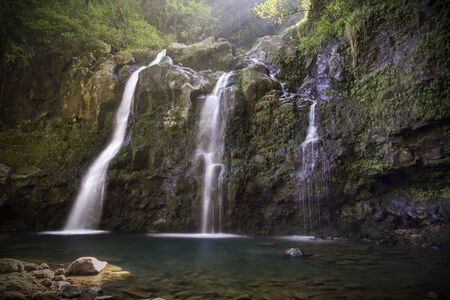Tripple Waterfall called Upper Waikuni Falls or Three Bear Falls of the Wailua Nui Stream along the Road to Hana on Maui Island in Hawaii. photo