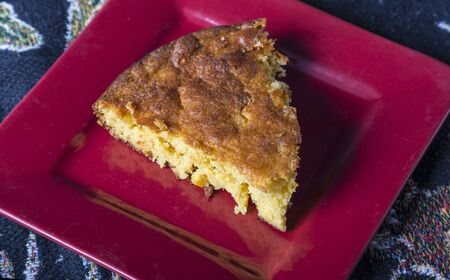 Home Style corn bread being served on a small plate. Stock Photo