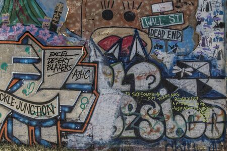 Bisbee, AZ, USA - May 24, 2015: Colored graffiti on a  wall in quirky Bisbee. Stock Photo