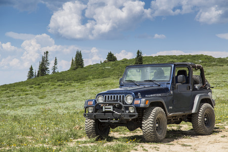 wasatch: Castle Dale, Utah - June 30, 2015: Jeep Wrangler Rubicon on a back country four wheel drive trail along Utahs Skyline Drive. Editorial