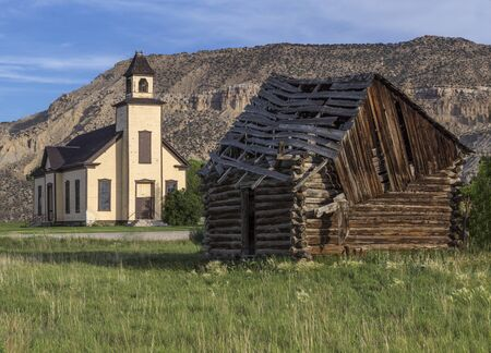 emery: An old abandoned Mormon Church and a cabin built by Mormon settlers in Emery Utah. Stock Photo
