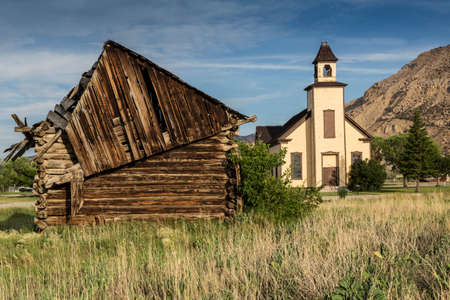 settler: An old abandoned Mormon Church and a cabin built by Mormon settlers in Emery Utah. Stock Photo