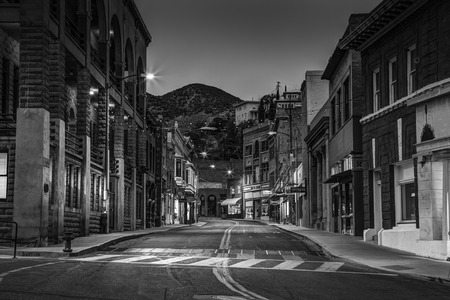 mining town: Bisbee, AZ - MAY 24, 2015: Downtown Historic Bisbee, Arizona - formerly a copper mining town - photographed at at night in black and white.