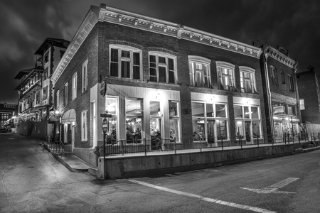 resturant: Bisbee, AZ - MAY 24, 2015: Downtown Historic Bisbee, Arizona - formerly a copper mining town - photographed at night in Black and White.