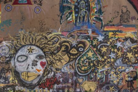 Bisbee, AZ, USA - May 24, 2015: Colored graffiti on a wall in quirky Bisbee. Editorial