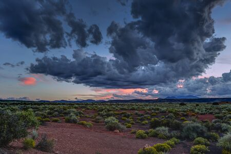 Desert vista at sunset near Flagstaff Arizona with the San Francisco Peaks in the distant background.