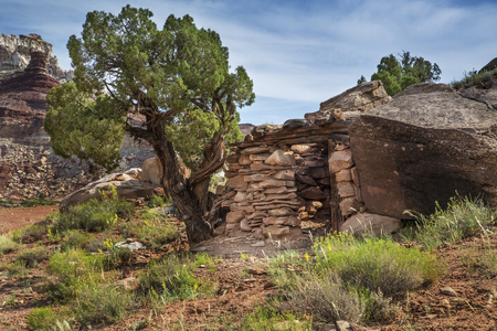 Stone miner cabin ruin at an abandoned radium mine from the 1880s in the San Rafael Swell in Utah near Temple Mountain. Stock Photo