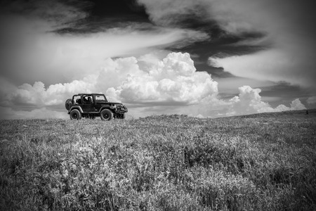 wasatch: SS Caption Castle Dale, Utah - June 30, 2015: Jeep Wrangler Rubicon on a back country four wheel drive trail along Utahs Skyline Drive. Editorial