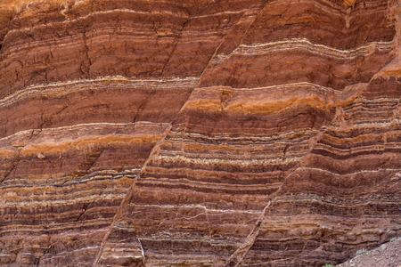 stratigraphy: Fault lines and colorful layers in sandstone also useful as a background or texture.