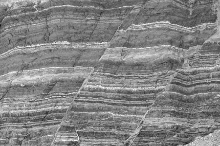 stratigraphy: Fault lines and layers in sandstone also useful as a background or texture in black and white. Stock Photo