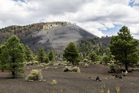 cinder: Sunset Crater volcanic cinder cone in Sunset Crater National Monument near Flagstaff Arizona. Stock Photo