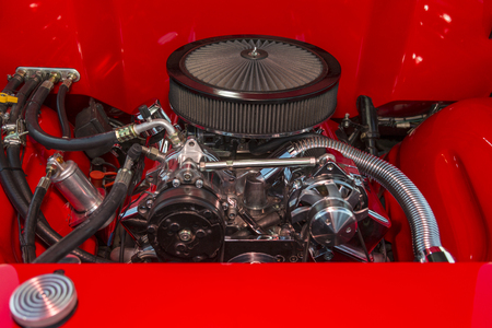 carburettor: V-8 engine in a classic hot rod with chrome Fittings.