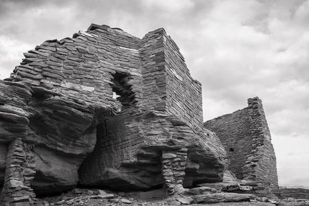 anasazi ruins: Wukoki pueblo ruin in Wupatki National Monument near Flagstaff  Arizona in black and white.
