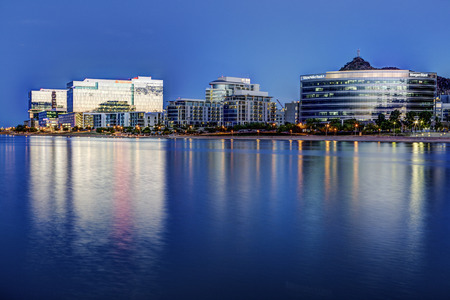 Tempe Arizona photographed from the Salt River during blue hour. Editorial