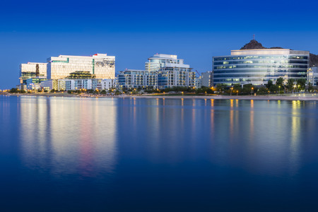 Tempe Arizona photographed from the Salt River during blue hour. Фото со стока