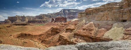Panoramic showing Hondu Arch with McKay Flat from Colorful Reds Canyon in the San Rafael Swell near Greenriver Utah in Emery County.