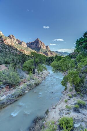 Sunset falls over Zion Canyon and the Virgin River in Utah. Stock Photo