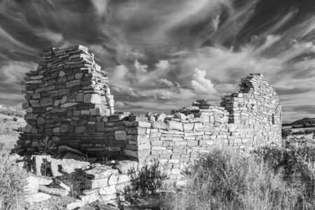 Box Canyon pueblo ruin in Wupatki National Monument near Flagstaff Arizona photographed in black and white.