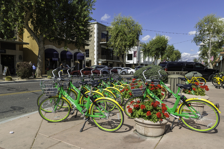 Scottsdale, Arizona USA – March 11, 2018: Community Rental Bicycles for Public use Using a Smart Phone App Available on a sidewalk in Scottsdale, Arizona USA.