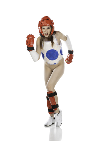 Nude woman in protective gear for martial arts, karate, taekwondo, or ultimate fighting (such as UFC or MMA).