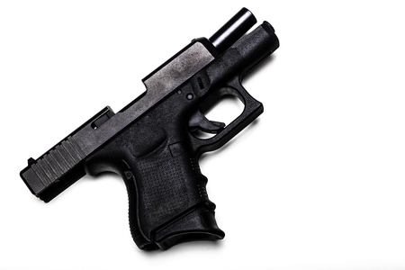 Automatic 9mm pistol with the bolt open isolated on a white background Stock Photo