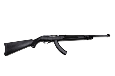 Black Ruger 22 caliber rifle with a high-capacity clip and laser sight isolated in white. 免版税图像