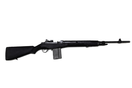 Black .303 caliber M1A rifle with a high-capacity clip isolated in white. Imagens