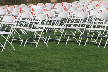 Folding Chairs set up on a green lawn for an event. Stock Photo - 847080