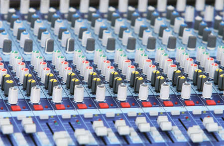 audio mixer: A audio mixer board. Spot focus on the center knobs.