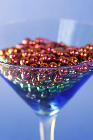 A martini glass full of titanium navel rings Stock Photo - 969000