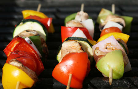 Grilling kabobs during a summer picnic at the park Stock Photo