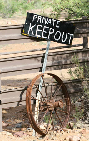 A KEEP OUT sign stands guard over the entrance to a ranch in Arizona photo