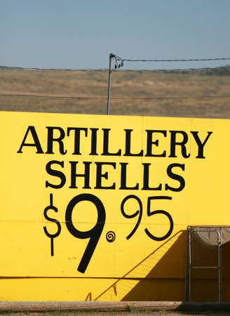 blow up: A sign advertising Artillery Shells for just $9.99. A great price to blow up whatever you had in mind
