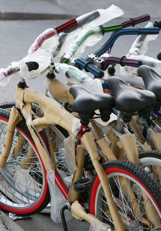 beach cruiser: New bikes are lined up for sale outside a shop in Central America Stock Photo