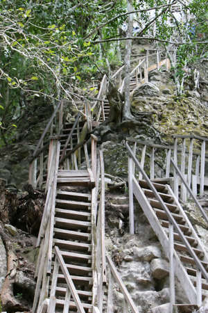 acrophobia: Rickety Stairs lead up to the top of a temple at Tikal