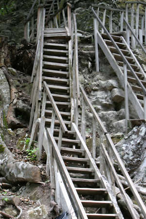 Steep stairs ascent the sides of a ancient Mayan temple at Tikal, Guatamala