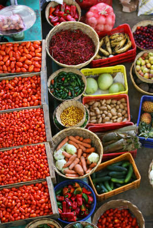 A colorful market of fresh fruits and vegetables photo